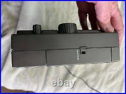 Eton E1XM radio and power cord